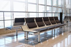 a group of empty seats on an airport waiting area